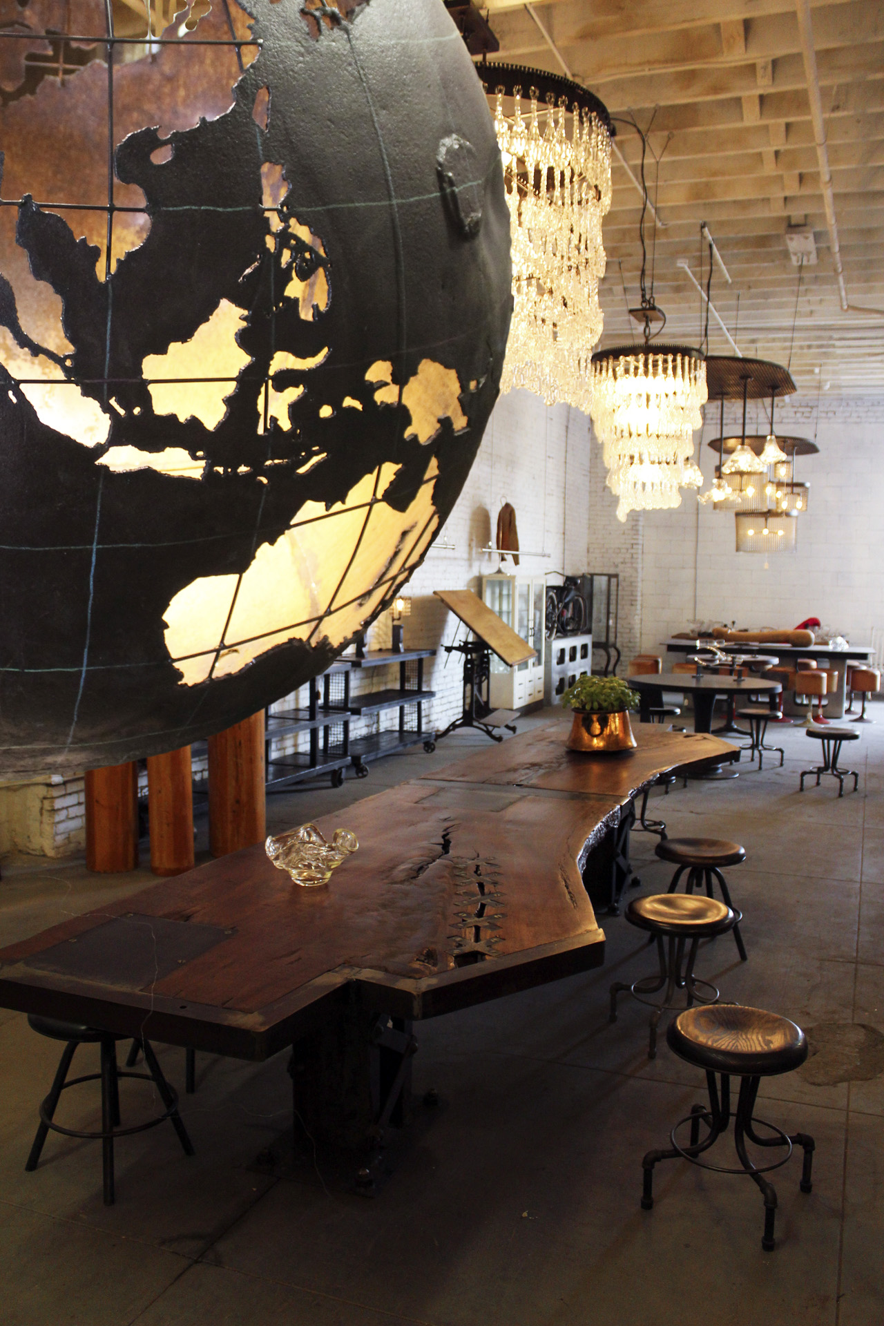 Cleveland Art's LA showroom features a Mooring buoy with the globe cut into it.