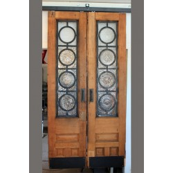 SLIDING RECLAIMED DOORS W/ RONDEL WINDOWS