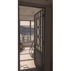 RECLAIMED STEEL DOOR W/ RONDEL WINDOW